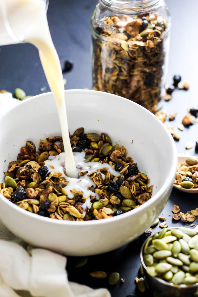 Crunchy & sweet, this Maple Walnut Granola is great with a splash of almond milk for breakfast - or sprinkle on top of smoothie bowls! Vegan & gluten-free.
