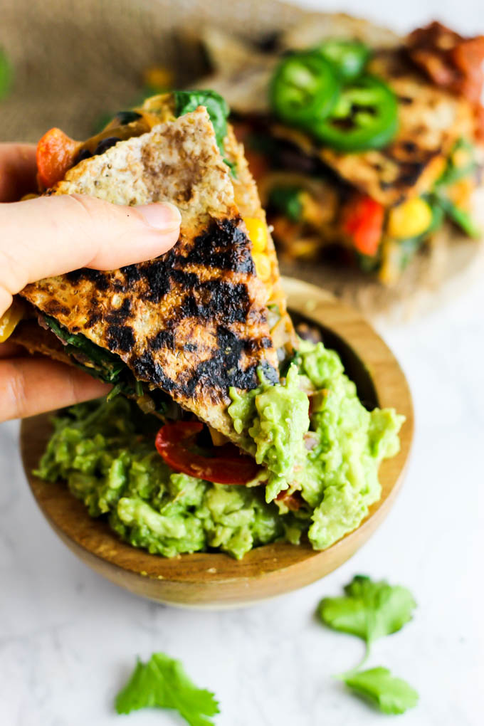 Vegan quesadilla with hummus vegetables emilie eats enjoy this vegan quesadilla with hummus vegetables for a healthy flavorful meal or appetizer forumfinder Gallery
