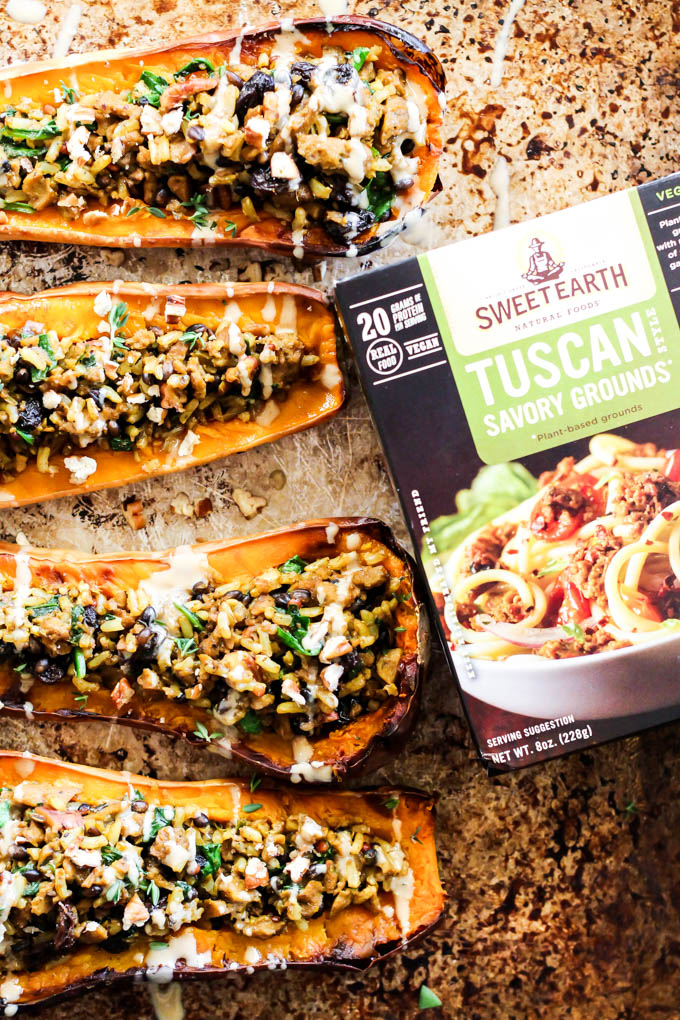 Take advantage of fresh squash with this easy Savory Vegan Stuffed Butternut Squash recipe! It's savory with a hint of sweet & perfect for the holidays.