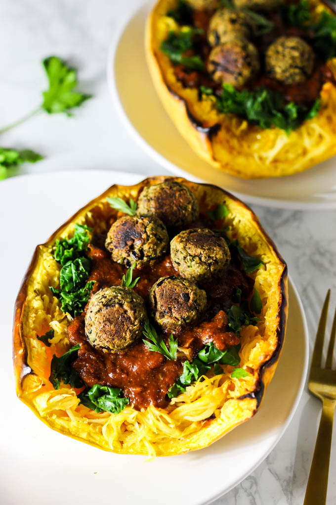 This Mushroom Spaghetti Squash recipe is a delicious, wholesome way to use seasonal squash! It's topped with a hearty mushroom sauce & vegan meatballs. (vegan & gluten-free)