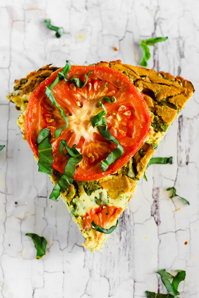 Serve this Vegan Caprese Quiche as a savory breakfast option full of plant protein thanks to chickpea flour and tofu! The seasonal tomatoes and basil make this a delicious, wholesome summer meal. (gluten-free)