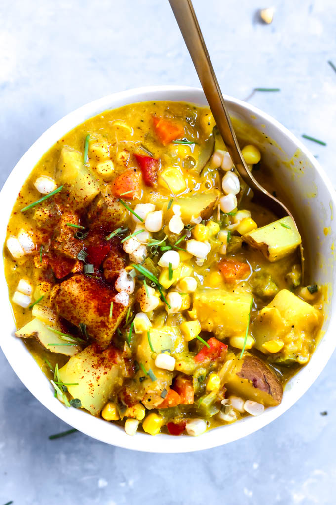 This rich Green Chile Corn Chowder is a comforting dinner you can whip up in one hour! Each bowl features sweet corn, hearty potatoes, and cashews for extra creaminess. Vegan & gluten-free!