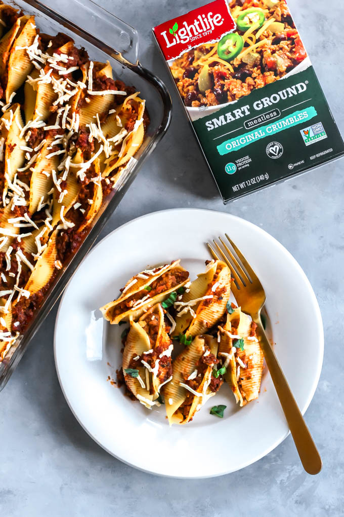 These Vegan Lasagna Stuffed Shells will be your family's go-to comfort food dinner! The shells are stuffed with tofu ricotta and a plant-based, meaty tomato sauce.