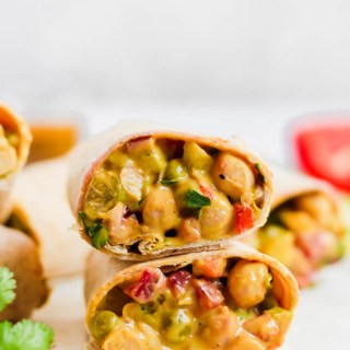 This Curried Chickpea Wrap is a simple, no-cook option for a quick lunch! Filled with beans, vegetables, & a creamy curry sauce, this wrap makes for a nutritious & satisfying meal.