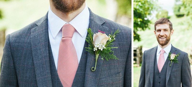 Groom's grey suit and pink tie