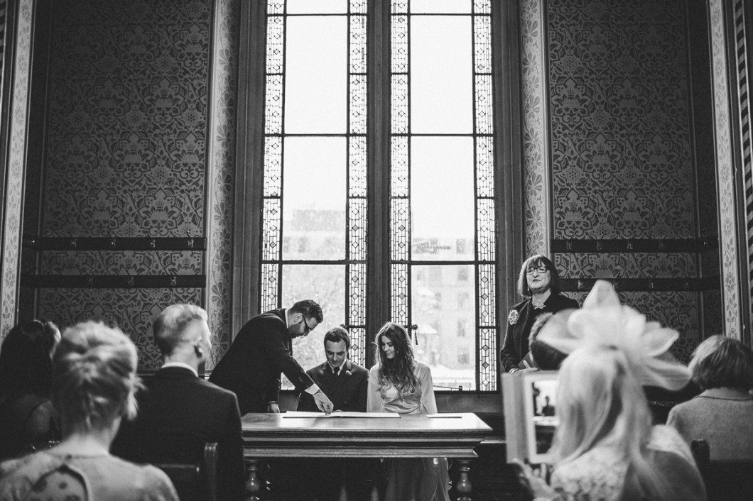 Signing the register at the wedding
