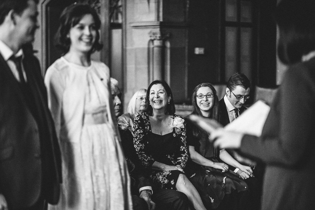 Happy wedding guests Manchester Town Hall