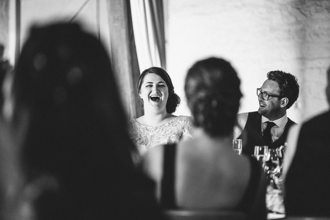 Laughing bride during speeches