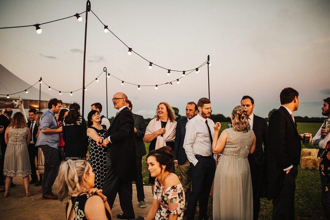 Festoon lights at the outdoor wedding
