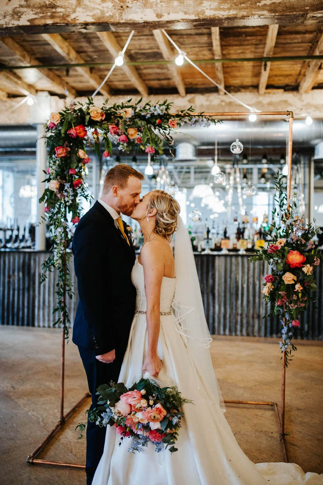 Industrial style wedding with colourful flowers