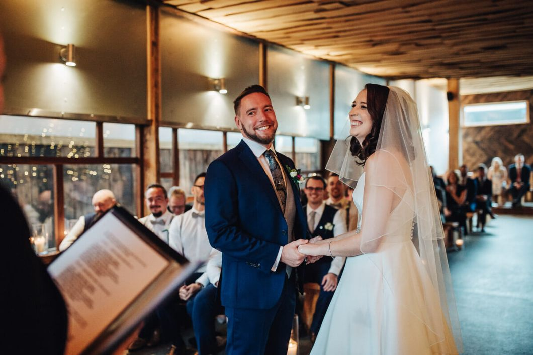 Bride and groom laughing during their vows