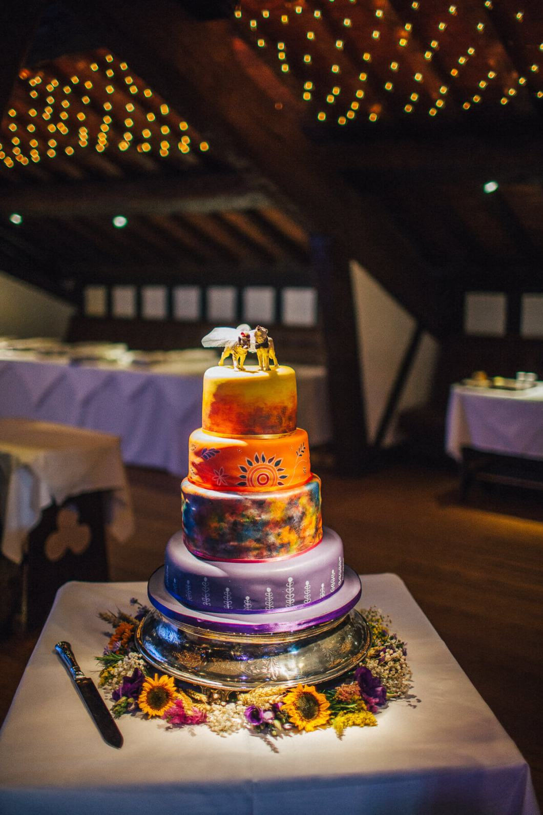 Hand painted wedding cake with wolf cake toppers