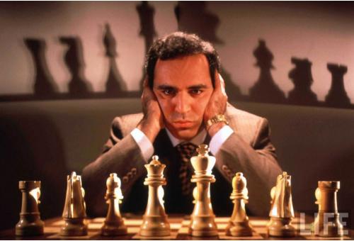 Garry Kasparov sits at chessboard
