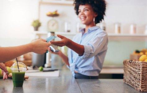 woman cashier taking customer credit card