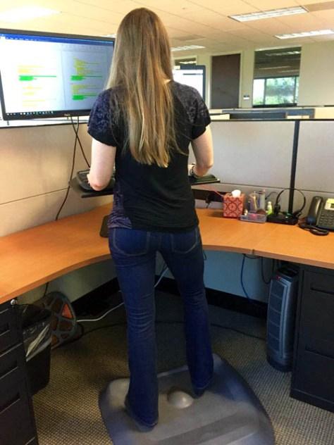 Emily standing on Topo floor mat