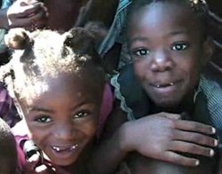 screenshot of children who will soon be getting XO laptops in Port-Au-Prince, Haiti from Waveplace video