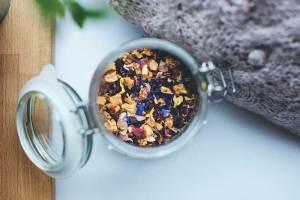 Glass jar full of colorful tea leaves