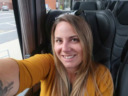 Girl in yellow dress on National Express Coach