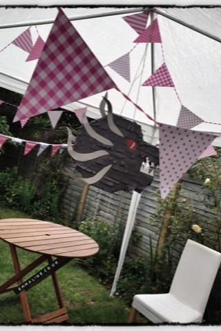 Jabberwocky piñata Alice in Wonderland party theme.