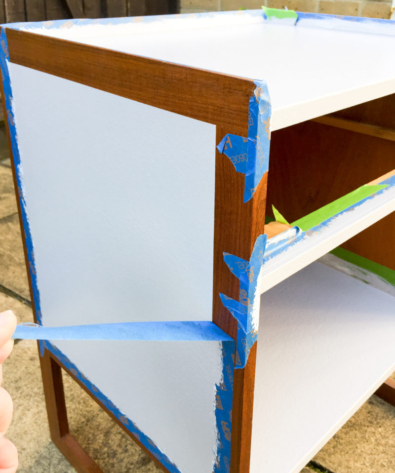Peeling painters tape off Refinished Mid-Century bedside tables