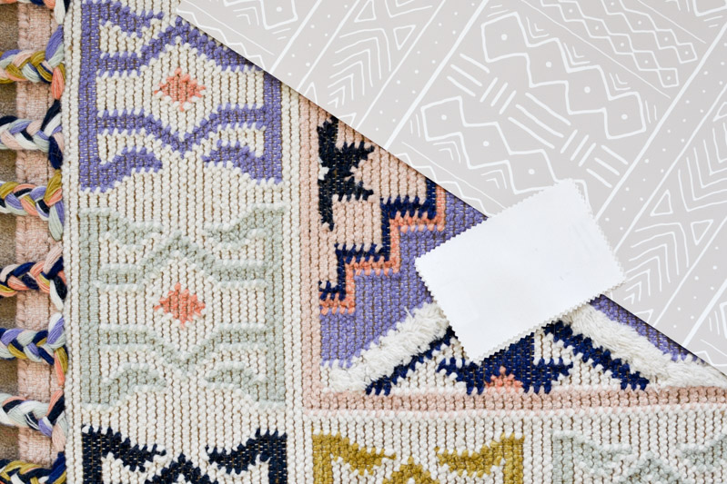 Removable mudcloth wallpaper by Domisticate on Spoonflower + Caravan rug from Anthropologie in Lilac
