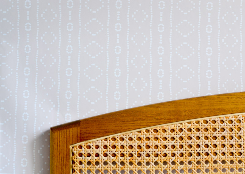 Behe_mudcloth Removable mudcloth wallpaper by Holli Zollinger on Spoonflower behind wicker headboard