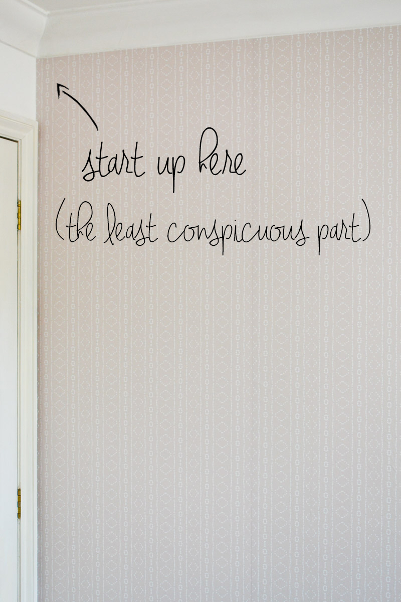 Start to hang removable wallpaper in the least conspicuous corner