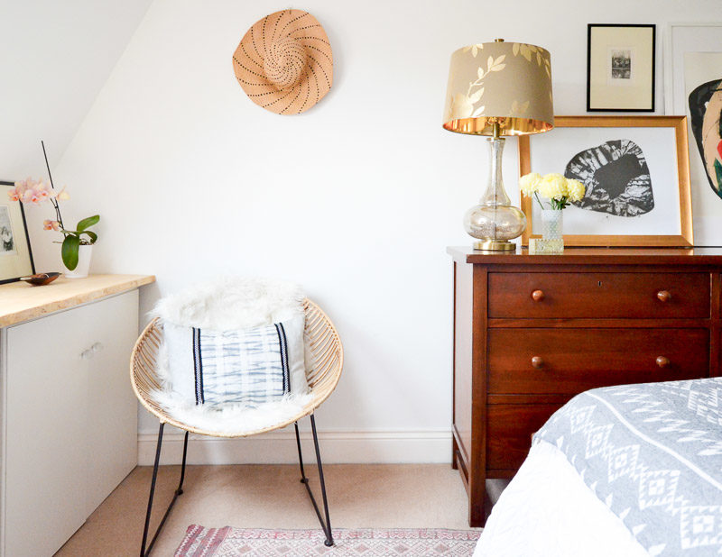 Wicker chair in neutral bedroom: Summer 17 Eclectic Home Tour