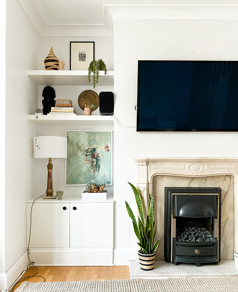 Built in shelves next to living room fireplace