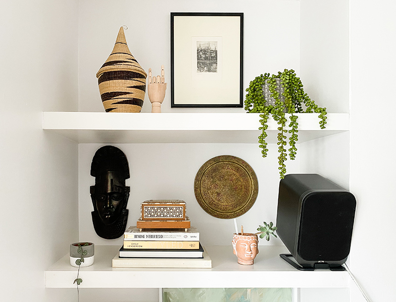 Shelf styling with global accessories, art and plants #shelfie