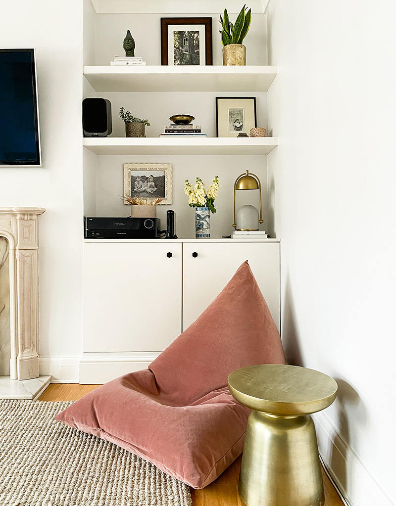 Blush pink bean bag from Made.com with styled built ins