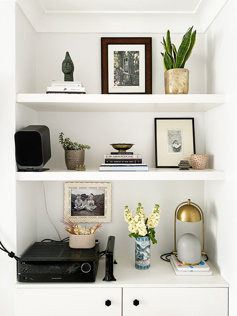 Shelf styling around electronics
