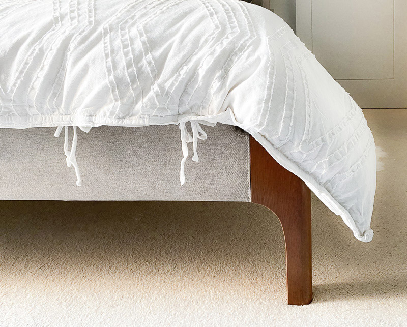 Bed legs and textured white bedding