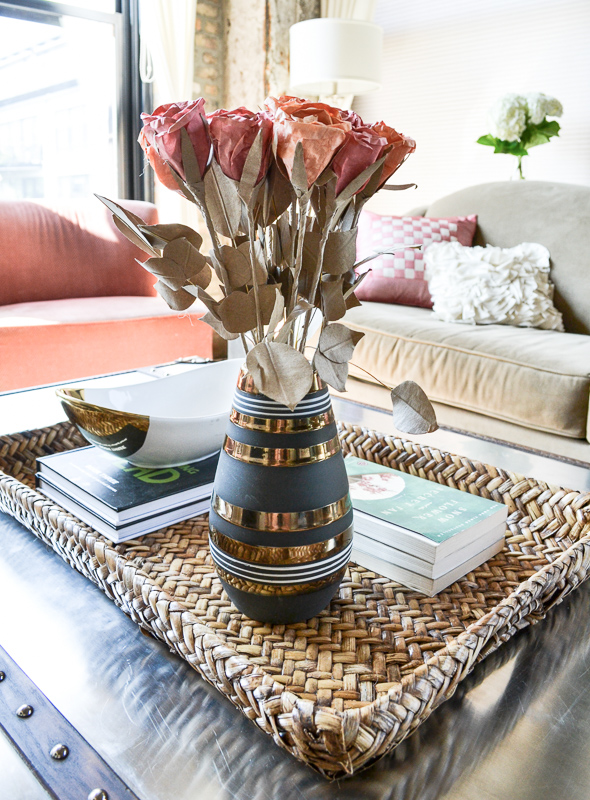 Wicker tray with paper flowers in vase