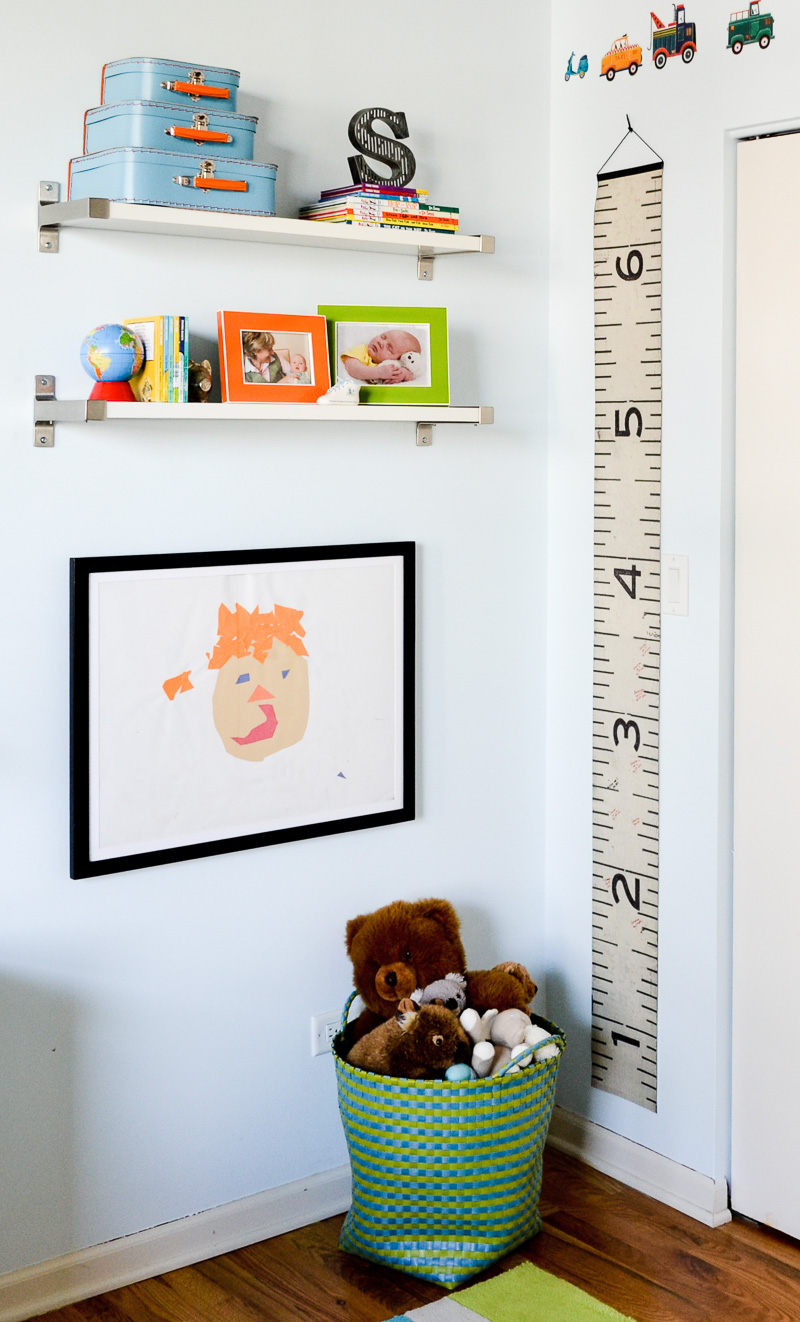 Industrial growth chart in blue toddler bedroom