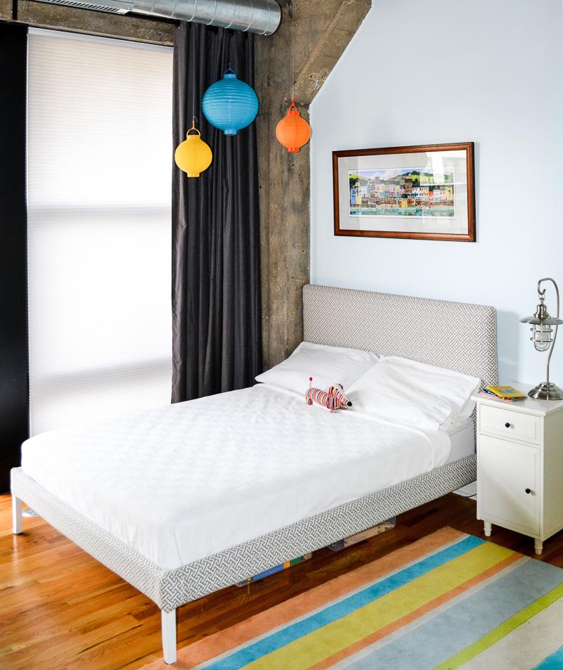 Industrial toddler bedroom with DIY bed frame