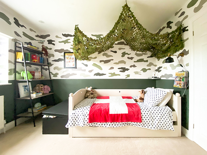 Camo kids bedroom with army netting bed canopy
