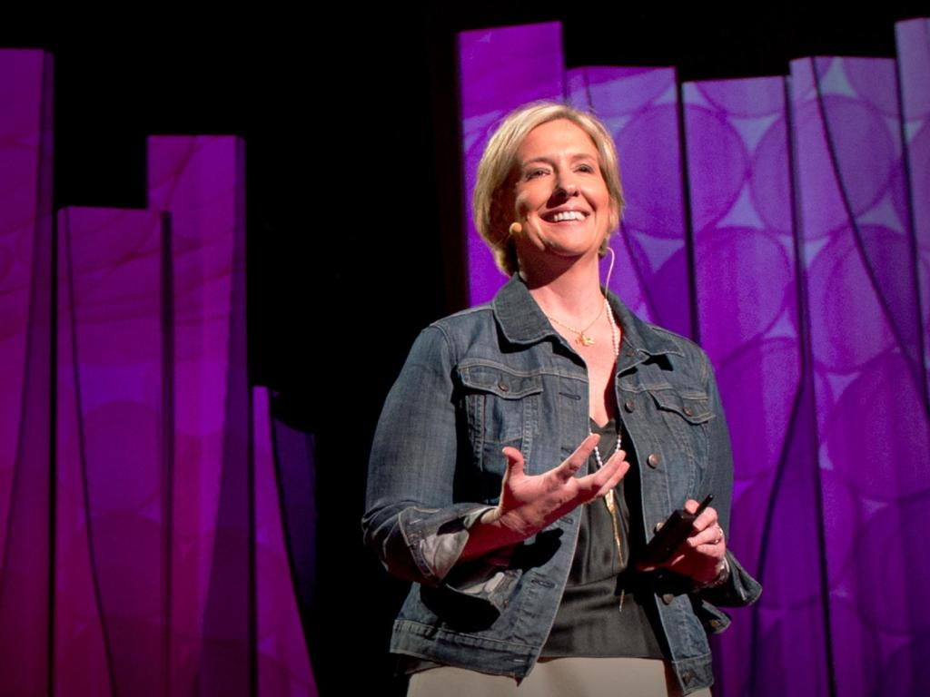 Brene Brown laughs on the stage at TED!!