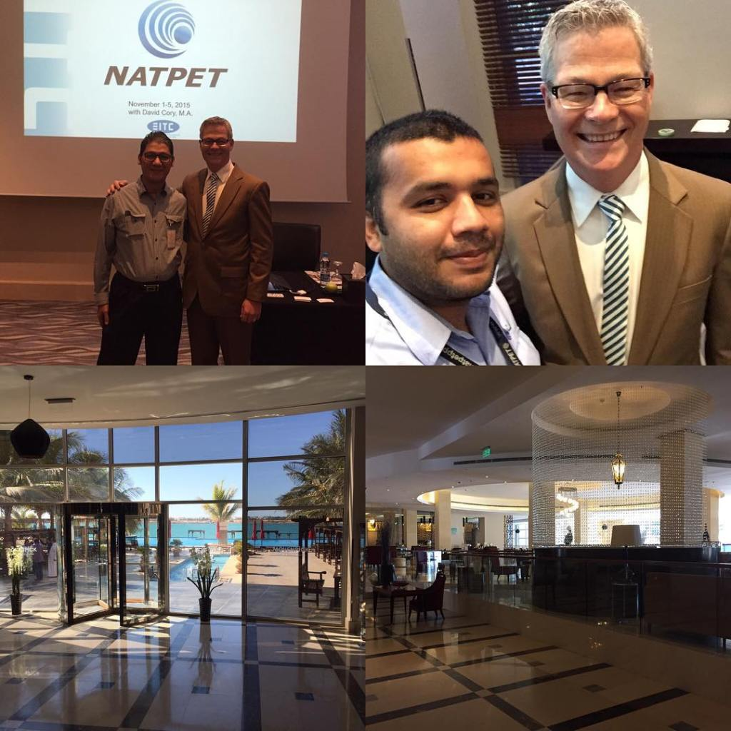 "Four photos: The top left shows two men standing shoulder to shoulder with their arms around each other indoors infront of a projected slide saying ""NATPET"". Top right is a photo of two men smiling and standing shoulder to shoulder. We see them from the shoulders up. Both have ties. The bottom two are from the inside of a hotel. The left looks down a hall, out a wall of floor to ceiling windows and out onto a beach."