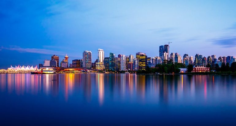 Twilight emerges in the early hours over the Vancouver city skyline and waterfront over Canada Place.