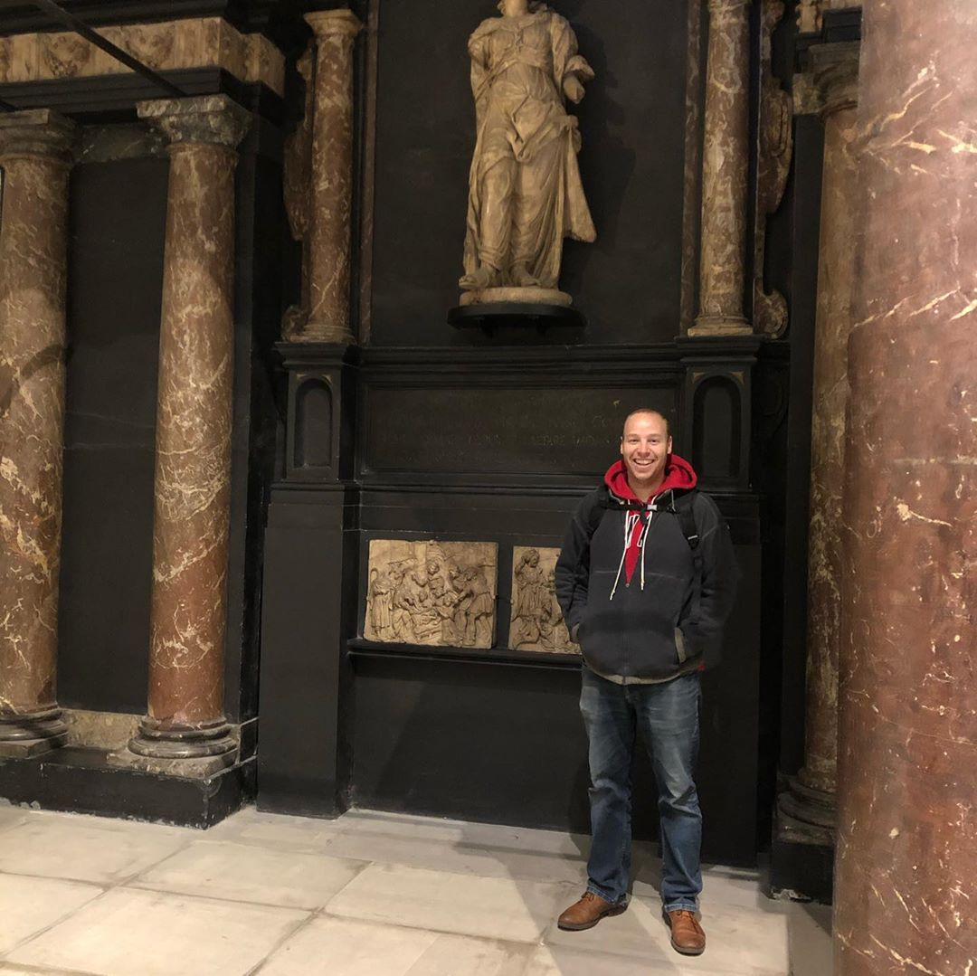 Jono Elliot stands in front of some columns in London.