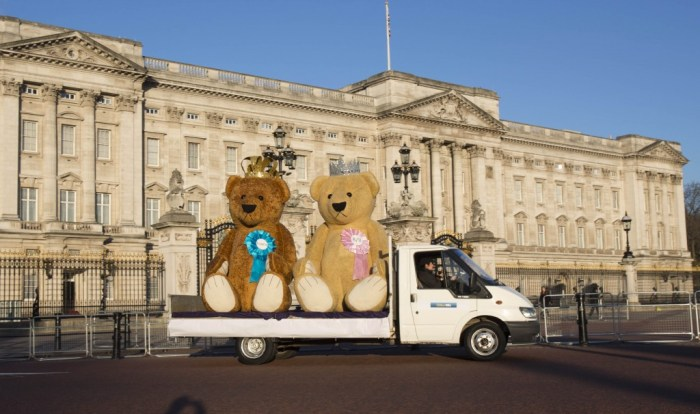 Two giant 3-metre high teddy bears, which have been created by William Hill, visit Buckingham Palace/Houses of Parliament during a tour of London today, to celebrate the imminent arrival of the second royal baby. Picture date: Tuesday April 7, 2015. The two bears, one boy and one girl, which are made from fur and cotton, each sport a crown and tiara respectively and display the odds of the sex of the baby on individual rosettes. The build took a team of sculptors and fabricators over two months to design, stuff and sew. Photo credit should read: Tim Anderson/Taylor Herring