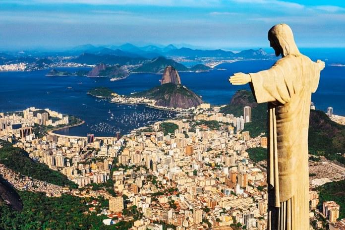 Brazil, Rio de Janeiro, Rio de Janeiro, Corcovado, Christ the Redeemer, Atlantic ocean, Cityscape with Christ the Redeemer, Sugarloaf Mountain in the background