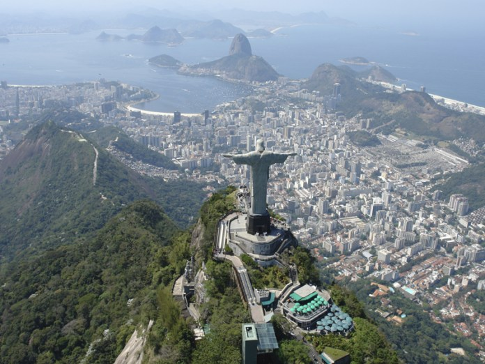 Christ the Redeemer atop the Corcovado hill, facing the Sugarloaf