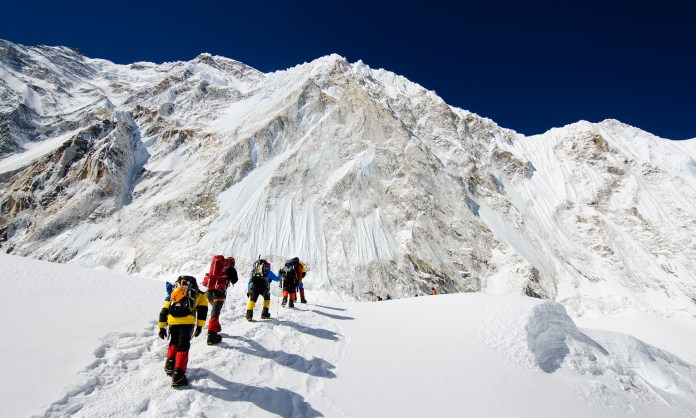 Asia, Nepal, Himalayas, Sagarmatha National Park, Solu Khumbu Everest Region, climbers walking below Nuptse making their way to camp 2 on Mt Everest