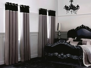 curtains in grey beside bed