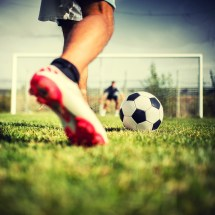 Soccer Players Playing Football