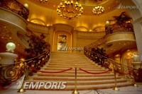 A grand staircase leading from the lobby to the art ...