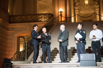 SFPD Capt. Paul Yep (second from right) looks on as David Overdorf (center) accepts his NEN Award for Most Inspiring Public Works Volunteer. Photo credit Tim Ho.