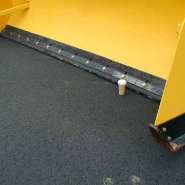 rubber tipped snow plow for snow plowing expansion joints